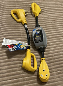 rv surge protector 30 amp camco (used) with 50 to 30 amp power grip (new)