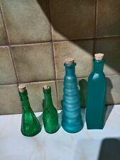 4 Glass bottles with cork ornamental.