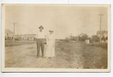 Man and woman on dirt road outside Original Antique Photo Postcard