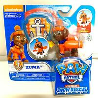 Paw Patrol Snow Rescue Zuma with Transforming Pup Pack and Badge.