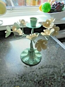 A  VINTAGE STYLE METAL BASE CANDLESTICK WITH METAL FLOWERS