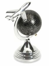 "Silver Cast Aluminum Circling Airplane Over Rotating Black World Globe 9.5"" Tall"