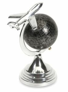 "Silver Cast Aluminum Circling Airplane Over Rotating Black World Globe 9.5"" Tall"