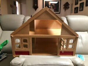 Wooden Dolls house with 24 pieces of wooden furniture