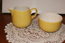 VINTAGE...CERAMIC...YELLOW , WITH WHITE INSIDE.....CREAMER AND SUGAR SET