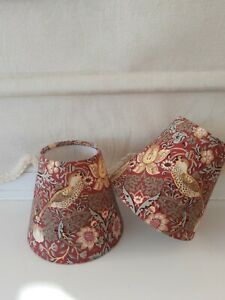 """A pair of handmade candle clip lampshades in  William Morris """"Strawberry Thief""""."""