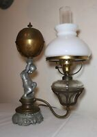 antique figural cherub electric argand oil lamp