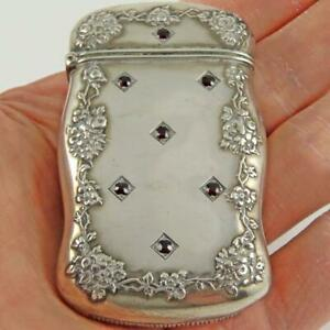ANTIQUE FAIRCHILD & CO. RUBY JEWELED REPOUSSE STERLING SILVER VESTA MATCH SAFE