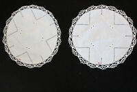 Two vintage off-white linen doilies with pretty embroidery and crochet edges.