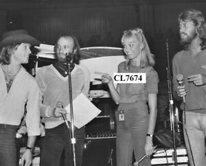 Maurice and Barry Gibb of The Bee Gees with Andy Gibb and Olivia Newton-John