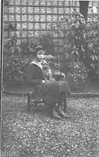 BK188 Carte Photo vintage card RPPC Femme chien dog assis chaise jardin