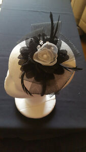 Fascinator - Black sinamay with white flower & feathers mounted on a headband