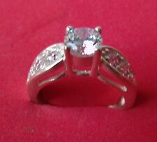 Ladies 1 carat  solitare with side stone  sterling silver, size 7 Diamonique