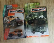 MATCHBOX   LOT OF 2 TOYOTA LAND CRUISER FJ40 CAMO SERIES MBX EXPLORERS VHTF