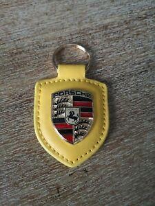Porte clef porsche jaune neuf