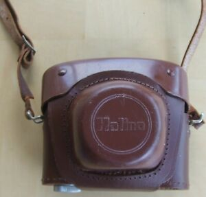 Old Halina 35 mm camera with case and strap