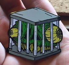 """'Caged"""" Grominator lapel (hat) pin from Phatpins"""