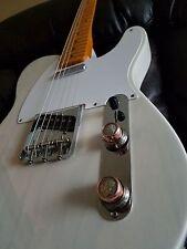 Guitar knobs with mercury dimes and Kennedy half dollar.