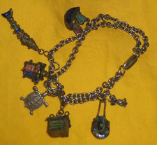 Charm bracelet 7 charms all with fine detail sterling and cloisonne vintage