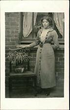 Young lady outside wndow plant on chair  qq589