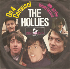 """7"""" The Hollies:  on a carousel / All the World is Love"""