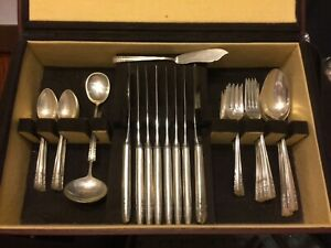 8 - FOUR PIECE PLACE SETTINGS OF STERLING SILVER FLATWARE - ALVIN - CHAPEL BELLS