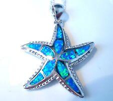 "STUNNING BLUE FIRE OPAL STAR FISH PENDANT + 20"" SILVER CHAIN."