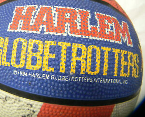 HARLEM GLOBETROTTER BALL WITH SOME SIGNATURES FROM THE GAME