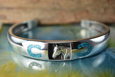 Sterling silver cuff style Bracelet w/ a Horse and crushed Turquoise Horseshoes