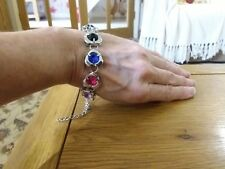 Brand new silver look bracelet with chunky silver hearts with coloured crystals
