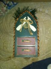 Decoration That Hangs Looks Like A Birdhouse With Drawers beautiful piece