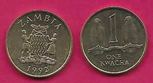ZAMBIA 1 KWACHA 1992 UNC TWO TAITA FALCONS ON BRANCH,NATIONAL ARMS WITH SUPPORTE