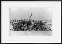 Photograph of Group of people in front of lifeboat on beach, Avalon, N.J.