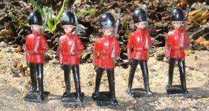 5 Vintage hollow cast guardsmen
