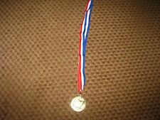 CARNIVAL CRUISE LINES MEDAL AWARD SOUVENIR ON RED WHITE BLUE RIBBON