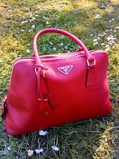 a3101a1bd6d7 Prada red saffiano leather medium sized handbag.