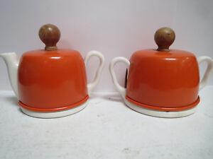 SUGAR BOWL AND CREAMER White Ceramic With Orange Metal 'Covers'