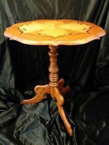 A vintage , wooden, brown ,round coffee table