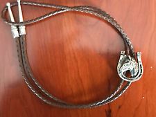 Western Bolo Tie With Silver Colored Horseshoe And Horse Head As Well As Tips
