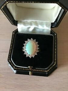 Fine 18ct gold large opal and diamond cluster ring