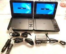 "2x Sony DVP-FX780 7"" Portable DVD/CD Player w/ 2 Car Adapters, 1 Wall Charger"