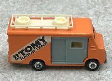 Vintage Tomica Isuzu Elf Hi-Roof Car No. 49 Tomy Racking Team Orange S-1/81
