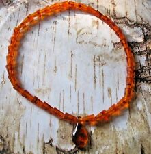 28  INCH  REAL AMBER NECKLACE WITH PENDANT... HAND STRUNG BEADS FROM POLAND