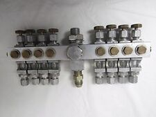 LUBE DEVICES INC  MANIFOLD OF NEEDLE VALVES WITH SIGHTS 1/8""