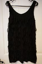 Dazzling little black dress size S from ING great ruffles all down whole dress
