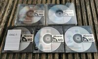Five Memorex 74 minute audio MiniDiscs. Used, Blank, Recordable. 2 with cases.