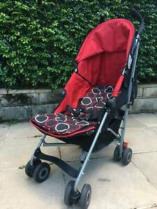 Maclaren Quest. Red and black. AS NEW CONDITION