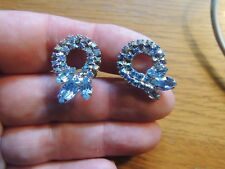 Vintage signed WEISS earrings, Aqua rhinestone bows. Rhodium plated, screw ons.