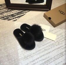 ugg fur slides. I have in black, brown, and gray. Very comfortable house slides.