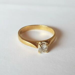 Superb quality solid 18kt gold solitaire 0.25ct diamond ring incl. valuation